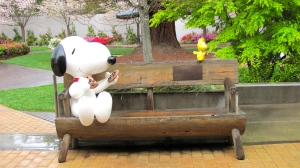 Snoopy and Woodstock sharing cookies in the garden at the Charles M. Schulz Museum.